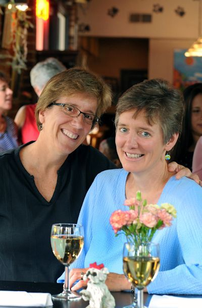 Town of Carrboro, NC Mayor Lydia Lavelle (L) and photographer Alicia Stemper, at the Spotted Dog restaurant in downtown Carrboro. Lavelle and Stemper were married on October 25, 2014 at the Carrboro Town Commons two weeks after same-sex marriage became legal in North Carolina on October 10, 2014. Lavelle and Stemper had a commitment ceremony in September 2004. Source: Chapel Hill/Orange County Visitors Bureau