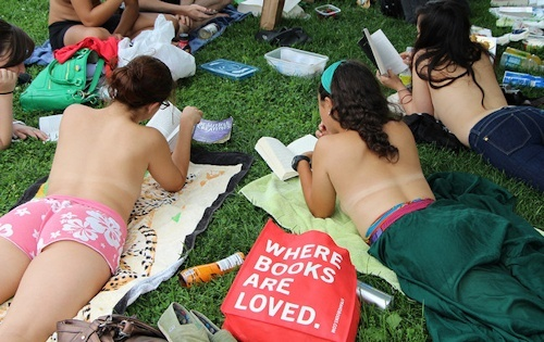 Topless book club meeting in an NYC park.